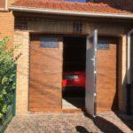 La porte sectionnelle avec portillon intégré